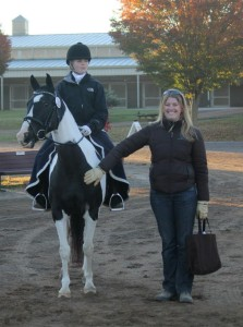 Lauren Sprieser helps a student get ready for a dressage test
